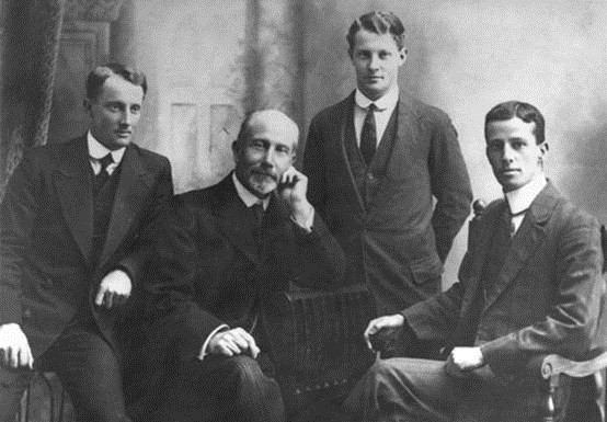 Ring with his sons, from left, Leslie, Gus and Claude.