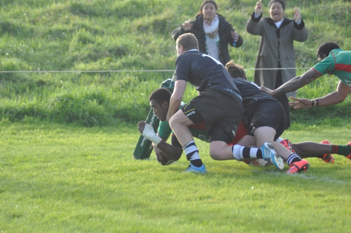 *Isei Lewaqai crashes over in the corner for a try